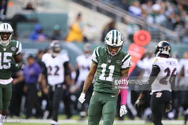 Wide Receiver Robby Anderson of the New York Jets has a long gain against the Baltimore Ravens during their game at MetLife Stadium on October 23...