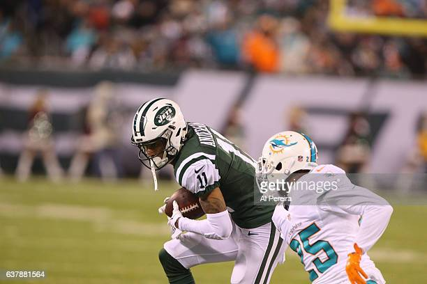 Wide Receiver Robby Anderson of the New York Jets has a long gain against the Miami Dolphins at MetLife Stadium on December 17 2016 in East...
