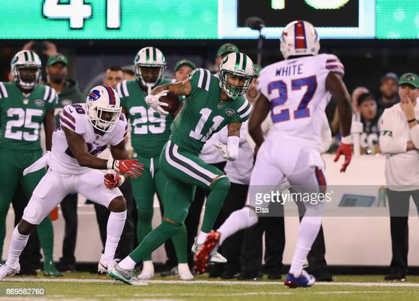 Wide receiver Robby Anderson of the New York Jets makes a catch for the firstdown against the cornerback Tre'Davious White of the Buffalo Bills...