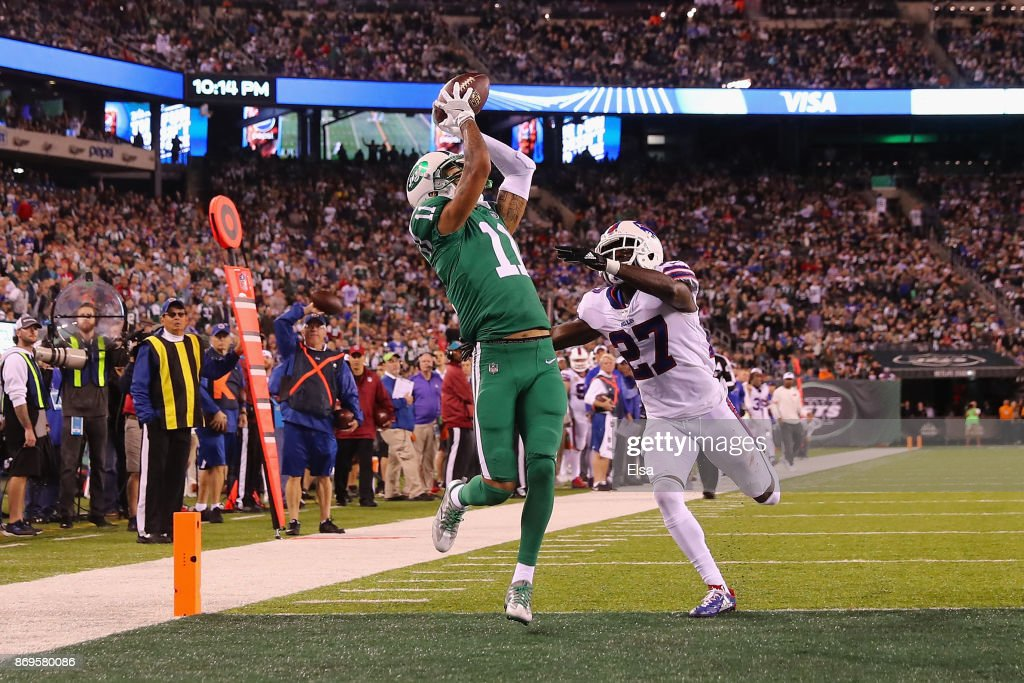 Wide receiver Robby Anderson #11 of the New York Jets makes a touchdown catch against cornerback Tre'Davious White #27 of the Buffalo Bills during the third quarter of the game at MetLife Stadium on November 2, 2017 in East Rutherford, New Jersey.