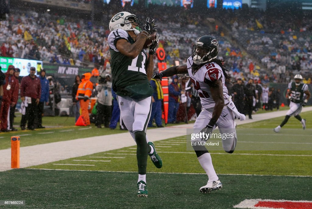 Wide receiver Robby Anderson #11 of the New York Jets scores a touchdown against cornerback Desmond Trufant #21 of the Atlanta Falcons during the second quarter of the game at MetLife Stadium on October 29, 2017 in East Rutherford, New Jersey.