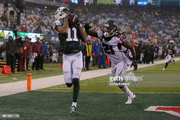 Wide receiver Robby Anderson of the New York Jets scores a touchdown against cornerback Desmond Trufant of the Atlanta Falcons during the second...