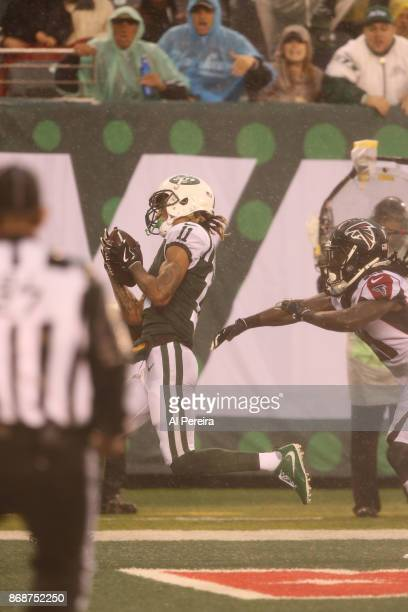 Wide Receiver Robby Anderson of the New York Jets scores a Touchdown against the Atlanta Falcons in a heavy rain storm during their game at MetLife...