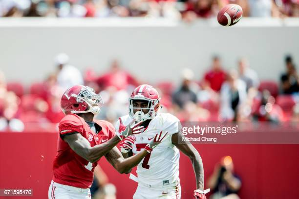 Wide receiver Robert Foster of the Alabama Crimson Tide catches a pass in front of linebacker Dylan Moses of the Alabama Crimson Tide at BryantDenny...