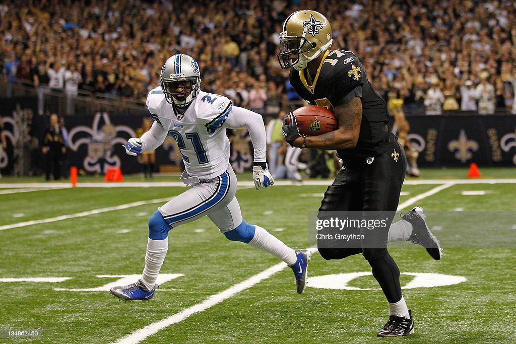 Wide receiver <a gi-track='captionPersonalityLinkClicked' href=/galleries/search?phrase=Robert+Meachem&family=editorial&specificpeople=2128641 ng-click='$event.stopPropagation()'>Robert Meachem</a> #17 of the New Orleans Saints runs past cornerback Eric Wright #21 of the Detroit Lions after a catch for a 67 yard touchdown at Mercedes-Benz Superdome on December 4, 2011 in New Orleans, Louisiana.
