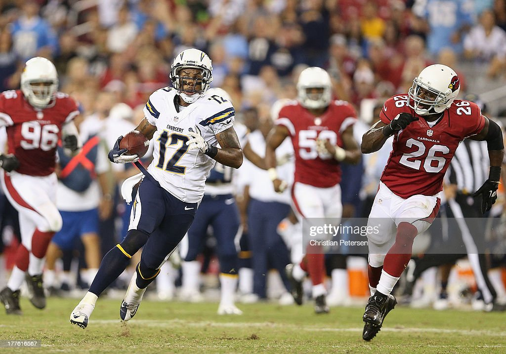Wide receiver Robert Meachem #12 of the San Diego Chargers runs with the football after a reception past defensive back Curtis Taylor #26 of the Arizona Cardinals during the preseason NFL game at the University of Phoenix Stadium on August 24, 2013 in Glendale, Arizona.