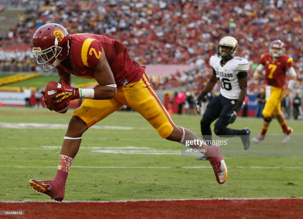Wide receiver Robert Woods #2 of the USC Trojans catches a pass for a touchdown against the Colorado Buffaloes in the first quarter at Los Angeles Memorial Coliseum on October 20, 2012 in Los Angeles, California. USC defeated the Colorado 50-6.