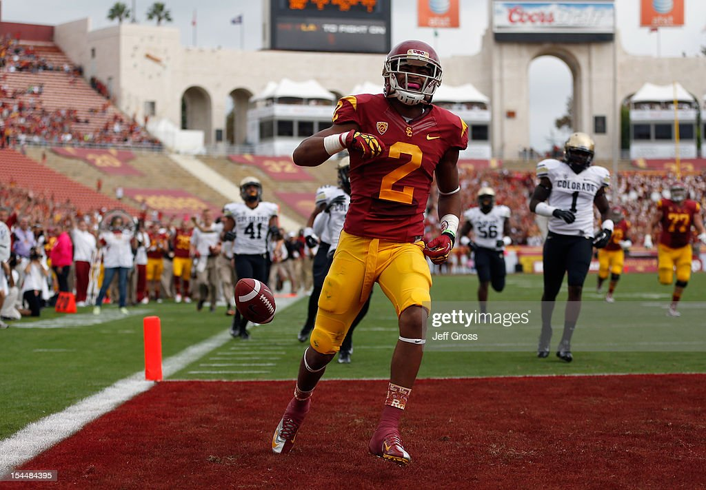 Wide receiver Robert Woods #2 of the USC Trojans celebrates a touchdown in the first quarter against the Colorado Buffaloes at Los Angeles Memorial Coliseum on October 20, 2012 in Los Angeles, California. USC defeated Colorado 50-6.
