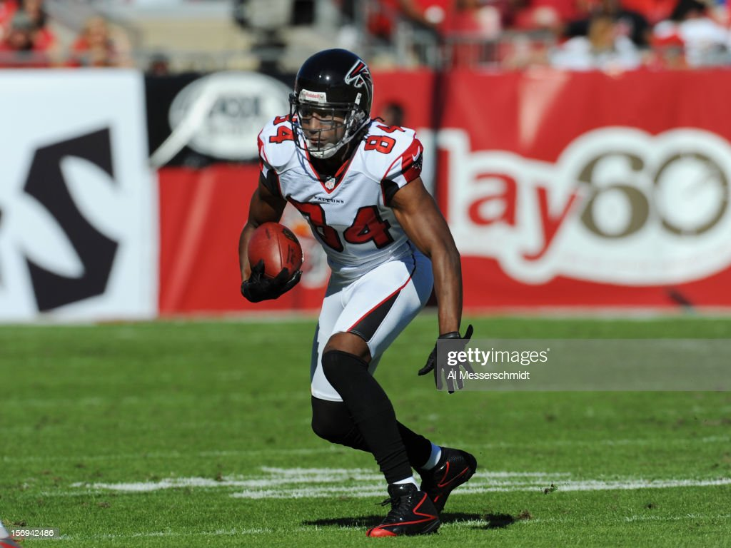 Wide receiver <a gi-track='captionPersonalityLinkClicked' href=/galleries/search?phrase=Roddy+White&family=editorial&specificpeople=750386 ng-click='$event.stopPropagation()'>Roddy White</a> #84 of the Atlanta Falcons rushes upfield with a pass against the Tampa Bay Buccaneers November 25, 2012 at Raymond James Stadium in Tampa, Florida. The Falcons won 24 - 23.