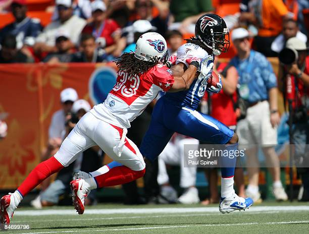 Wide receiver Roddy White of the NFC AllStars Atlanta Falcons catches a pass and gets tackled by safety Michael Griffin of the AFC AllStars Tennessee...