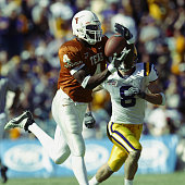 Wide receiver Roy Williams of the University of Texas Longhorns catches a pass against free safety Jack Hunt of the Louisiana State University Tigers...