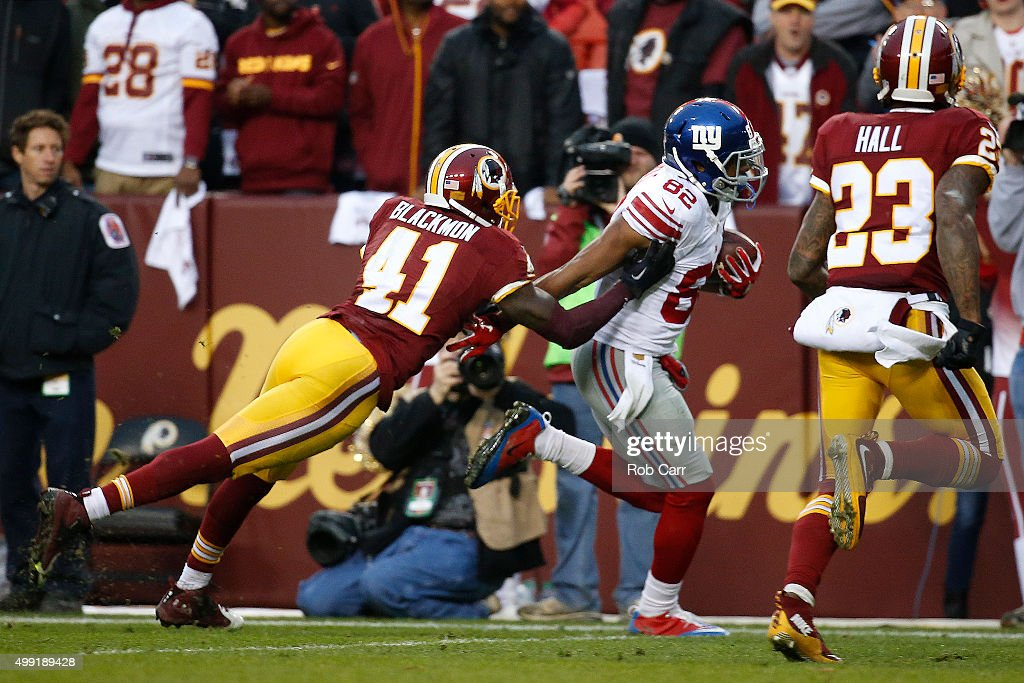 Wide receiver Rueben Randle of the New York Giants scores a fourth quarter touchdown past cornerback Will Blackmon of the Washington Redskins and...