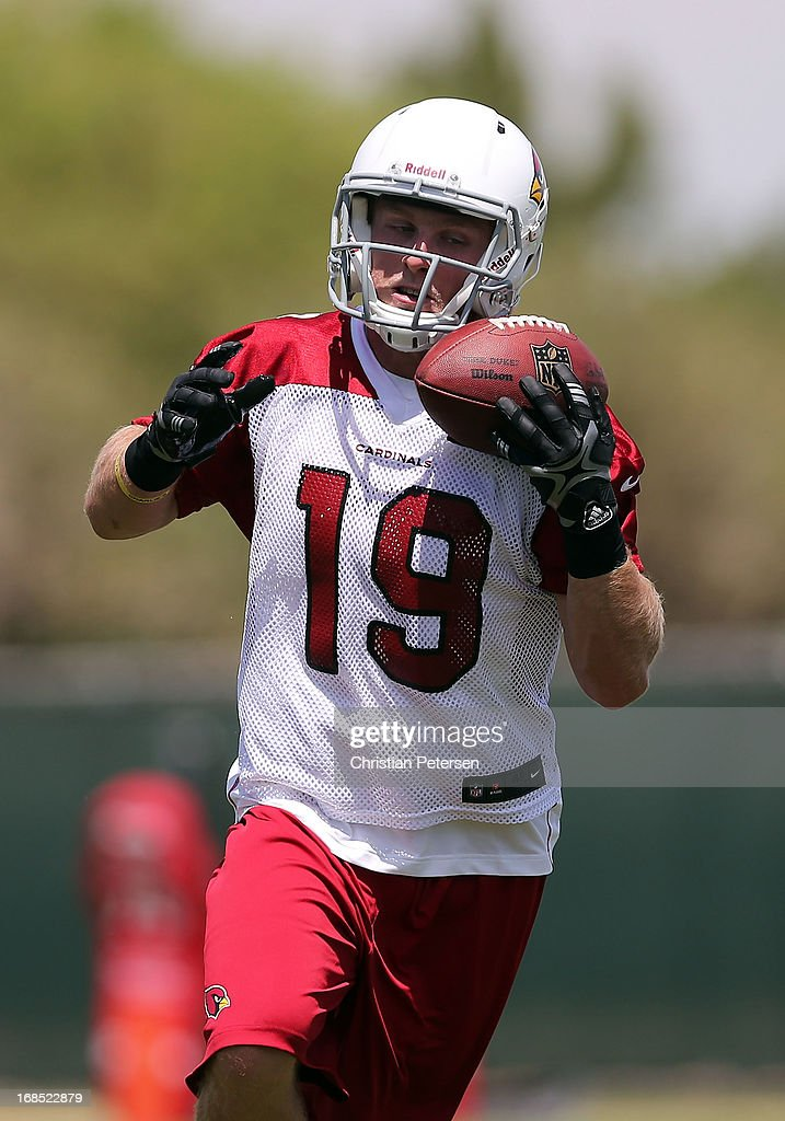 Wide receiver Ryan Swope #19 of the Arizona Cardinals catches a pass as he practices at the team's training center facility on May 10, 2013 in Tempe, Arizona.