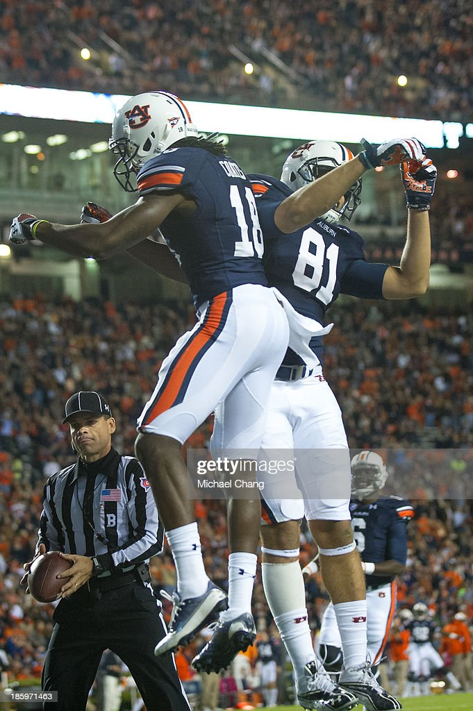 Wide receiver Sammie Coates #18 celebrates with wide receiver Melvin Ray #82 of the Auburn Tigers after scoring a touchdown against the Florida Atlantic Owls during the second quarter of play on October 26, 2013 at Jordan-Hare Stadium in Auburn, Alabama. At the end of the first quarter Auburn leads Florida Atlantic 21-0.