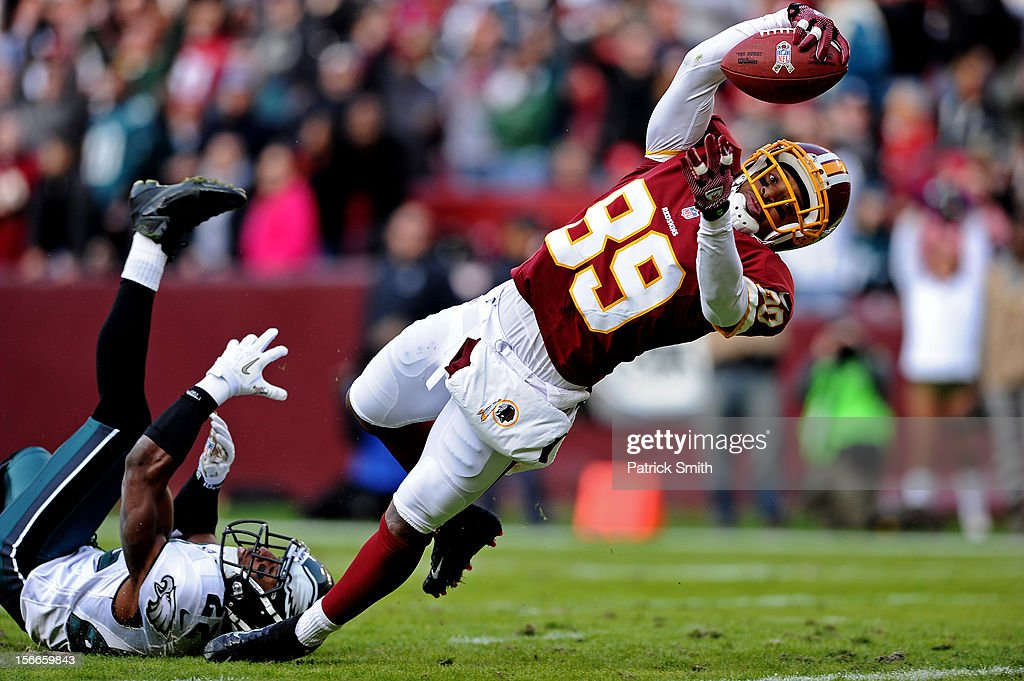 Wide receiver Santana Moss #89 of the Washington Redskins dives into the end zone past cornerback Brandon Boykin #22 of the Philadelphia Eagles to score a touchdown in the third quarter at FedEx Field on November 18, 2012 in Landover, Maryland.