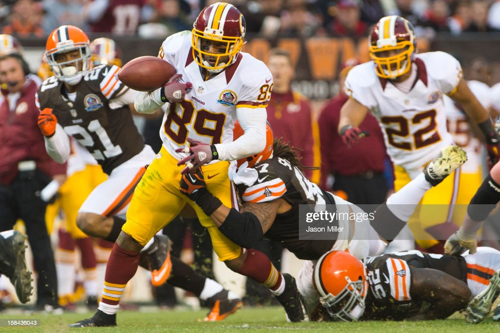 Wide receiver <a gi-track='captionPersonalityLinkClicked' href=/galleries/search?phrase=Santana+Moss&family=editorial&specificpeople=204490 ng-click='$event.stopPropagation()'>Santana Moss</a> #89 of the Washington Redskins fumbles the ball during the second half against the Cleveland Browns at Cleveland Browns Stadium on December 16, 2012 in Cleveland, Ohio. The Redskins defeated the Browns 38-21.