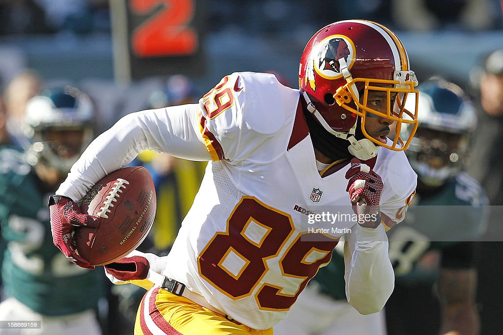 Wide receiver Santana Moss #89 of the Washington Redskins runs with the ball during a game against the Philadelphia Eagles on December 23, 2012 at Lincoln Financial Field in Philadelphia, Pennsylvania. The Redskins won 27-20.