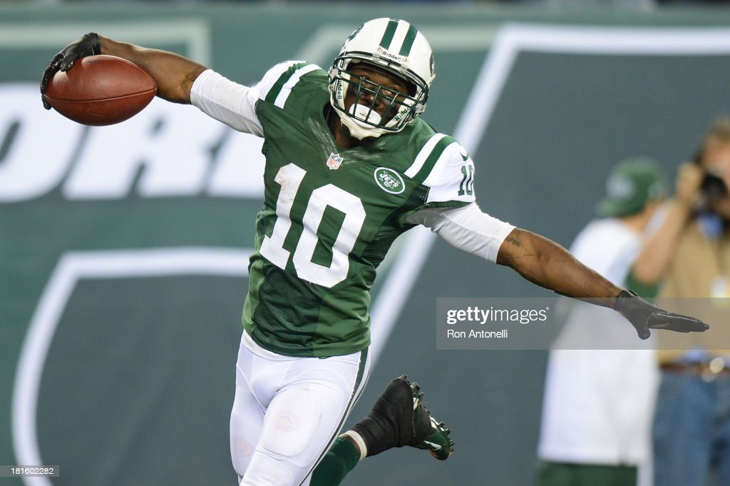 Wide receiver <a gi-track='captionPersonalityLinkClicked' href=/galleries/search?phrase=Santonio+Holmes&family=editorial&specificpeople=618140 ng-click='$event.stopPropagation()'>Santonio Holmes</a> #10 of the New York Jets celebrates after his 69 yard touchdown catch in the 2nd half of the Jets 27-20 win over the Buffalo Bills at MetLife Stadium on September 22, 2013 in East Rutherford, New Jersey.