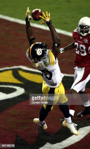 Wide Receiver Santonio Holmes of the Pittsburgh Steelers jumps up for a pass in the endzone against RogersCromartie of the Arizona Cardinals during...