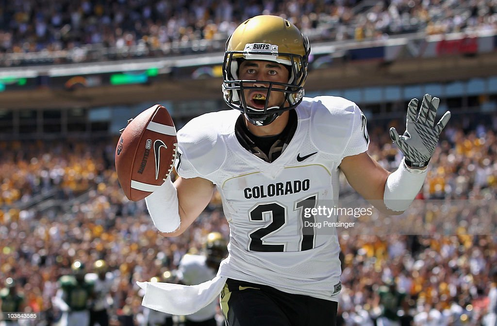 Wide receiver Scotty McKnight of the Colorado Buffaloes celebrates 27 yard touchdown reception to give the Buffs a 140 lead over the Colorado State...