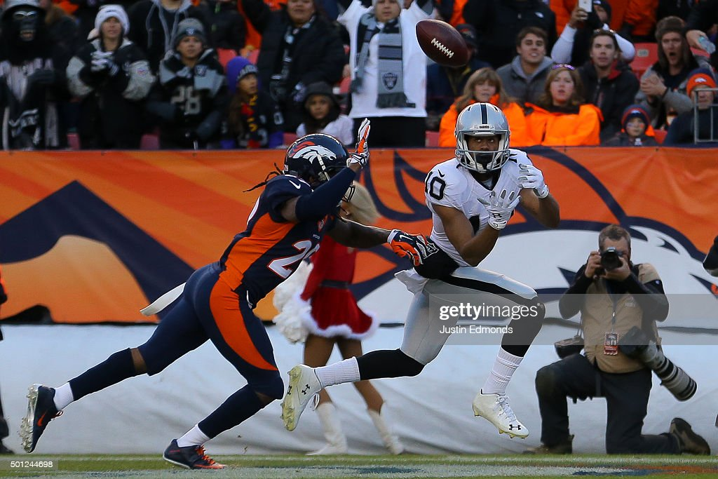 Wide receiver Seth Roberts #10 of the Oakland Raiders makes a catch for a third quarter touchdown against the Denver Broncos under coverage by free safety Bradley Roby #29 at Sports Authority Field at Mile High on December 13, 2015 in Denver, Colorado.