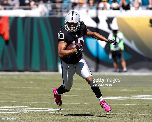 Wide Receiver Seth Roberts of the Oakland Raiders on a catch and run play during the game against the Jacksonville Jaguars at EverBank Field on...