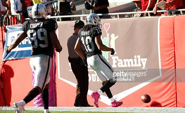Wide receiver Seth Roberts of the Oakland Raiders scores an overtime touchdown to win the game against the Tampa Bay Buccaneers with the 3024 win on...