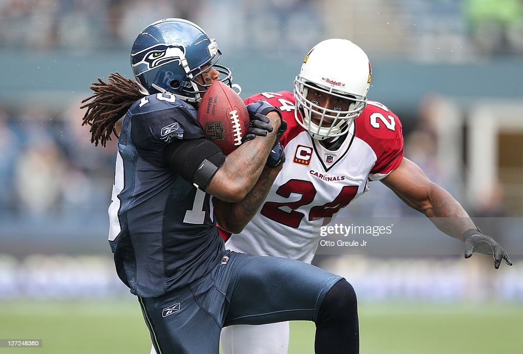 Wide receiver <a gi-track='captionPersonalityLinkClicked' href=/galleries/search?phrase=Sidney+Rice&family=editorial&specificpeople=793737 ng-click='$event.stopPropagation()'>Sidney Rice</a> #18 of the Seattle Seahawks makes a 52 yard catch against strong safety <a gi-track='captionPersonalityLinkClicked' href=/galleries/search?phrase=Adrian+Wilson+-+American+Football+Player&family=editorial&specificpeople=773272 ng-click='$event.stopPropagation()'>Adrian Wilson</a> #24 of the Arizona Cardinals at CenturyLink Field on September 25, 2011 in Seattle, Washington.