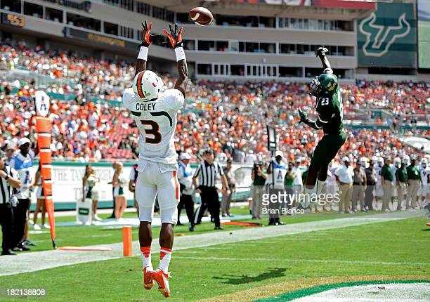 Wide receiver Stacy Coley of the Miami Hurricanes hauls in an 11yard touchdown pass in front of Defensive back Kenneth Durden of the South Florida...