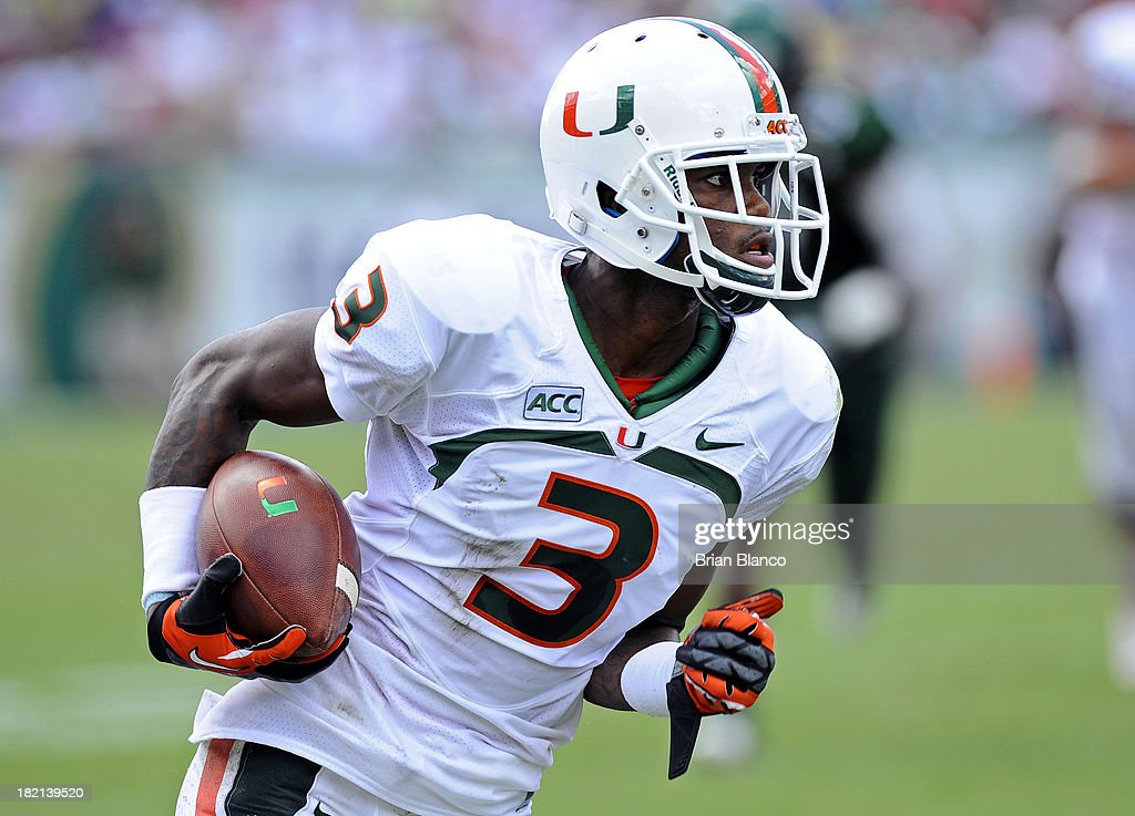 Wide receiver Stacy Coley #3 of the Miami Hurricanes runs for a first down during the first quarter against the South Florida Bulls on September 28, 2013 at Raymond James Stadium in Tampa, Florida.