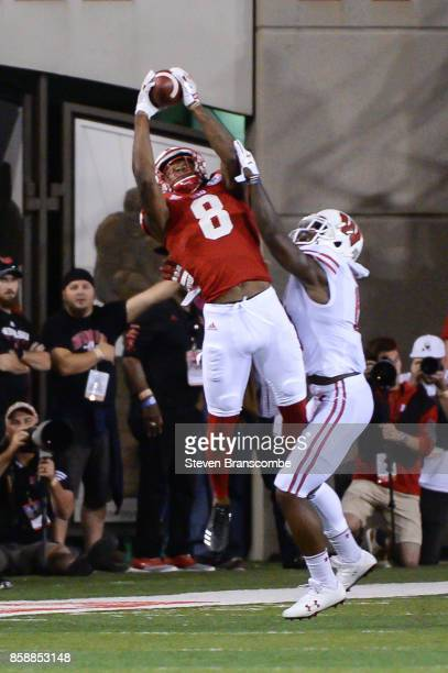 Wide receiver Stanley Morgan Jr #8 of the Nebraska Cornhuskers catches a pass against the Wisconsin Badgers at Memorial Stadium on October 7 2017 in...