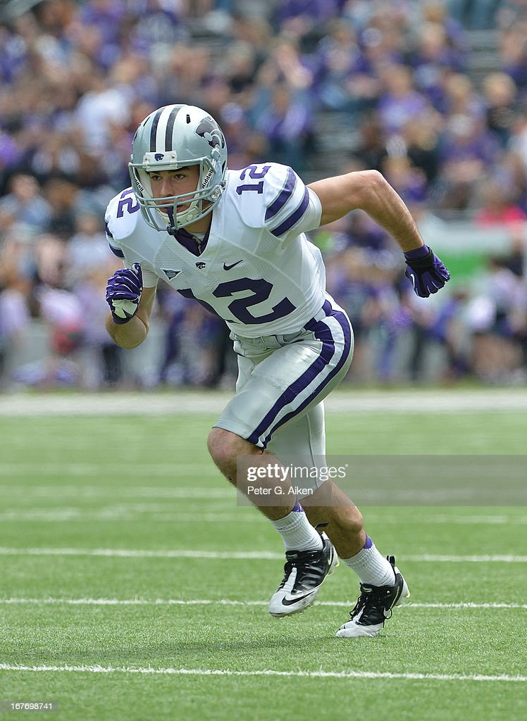 Wide receiver Stanton Weber #12 of the Kansas State Wildcats gets set on offense during the Purple and White Spring Game on April 27, 2013 at Bill Snyder Family Stadium in Manhattan, Kansas.