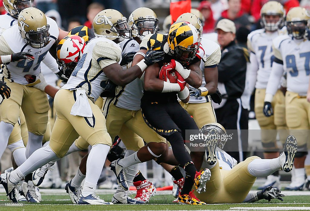 Wide receiver Stefon Diggs #1 of the Maryland Terrapins is tackled by the Georgia Tech Yellow Jackets defense during the first half at Byrd Stadium on November 3, 2012 in College Park, Maryland.