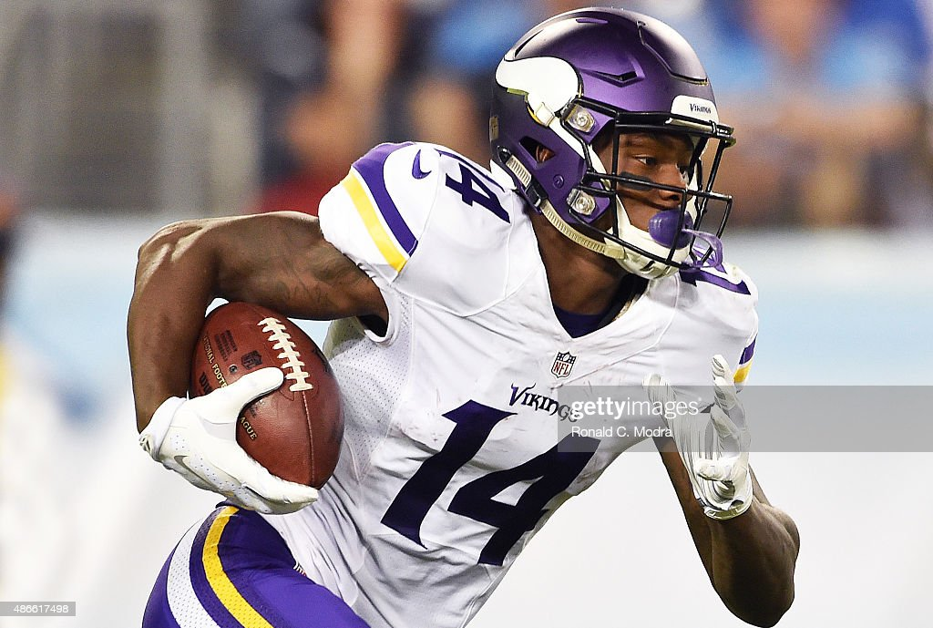 Wide receiver <a gi-track='captionPersonalityLinkClicked' href=/galleries/search?phrase=Stefon+Diggs&family=editorial&specificpeople=6786164 ng-click='$event.stopPropagation()'>Stefon Diggs</a> #14 of the Minnesota Vikings carries the ball during a NFL pre-season game against the Tennessee Titans at Nissan Stadium on September 3, 2015 in Nashville, Tennessee.