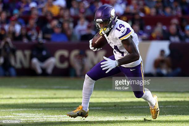 Wide receiver Stefon Diggs of the Minnesota Vikings carries the ball against the Washington Redskins in the second quarter at FedExField on November...