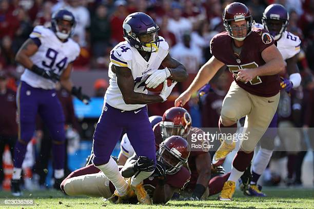 Wide receiver Stefon Diggs of the Minnesota Vikings carries the ball against cornerback Bashaud Breeland of the Washington Redskins in the second...