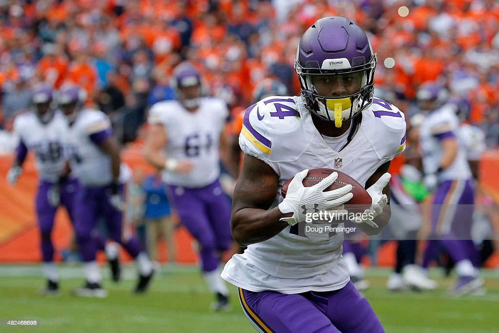 Wide receiver <a gi-track='captionPersonalityLinkClicked' href=/galleries/search?phrase=Stefon+Diggs&family=editorial&specificpeople=6786164 ng-click='$event.stopPropagation()'>Stefon Diggs</a> #14 of the Minnesota Vikings makes a pass reception against the Denver Broncos at Sports Authority Field at Mile High on October 4, 2015 in Denver, Colorado. The Broncos defeated the Vikings 23-20.