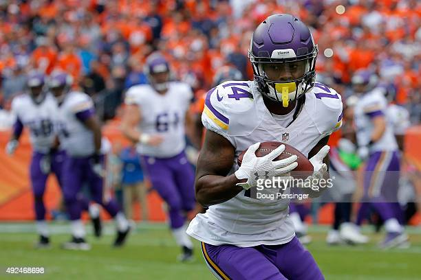 Wide receiver Stefon Diggs of the Minnesota Vikings makes a pass reception against the Denver Broncos at Sports Authority Field at Mile High on...