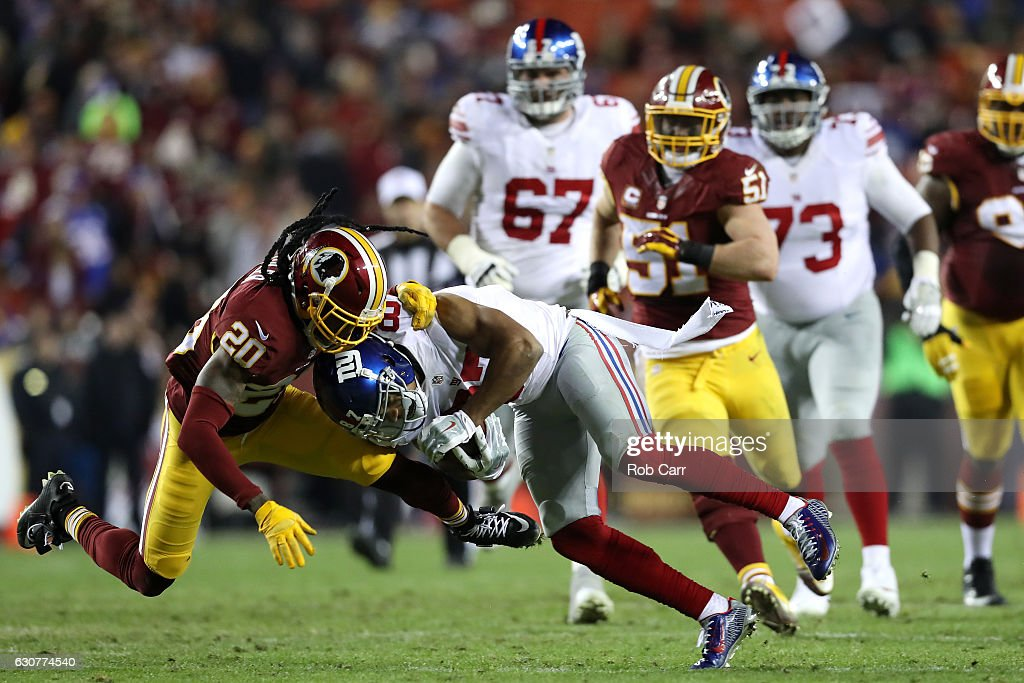 Wide receiver Sterling Shepard #87 of the New York Giants is tackled by defensive back Greg Toler #20 of the Washington Redskins in the second quarter at FedExField on January 1, 2017 in Landover, Maryland.