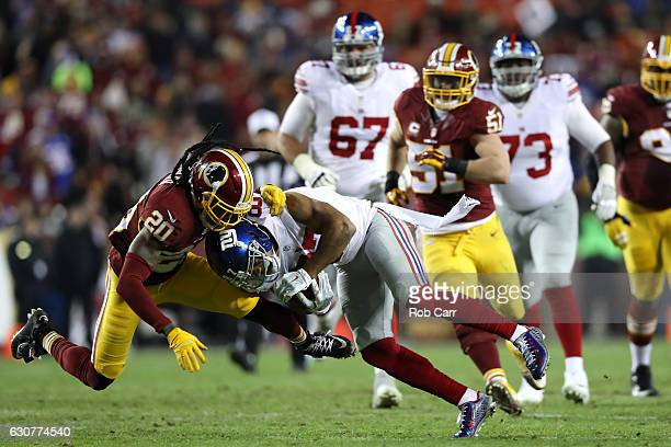 Wide receiver Sterling Shepard of the New York Giants is tackled by defensive back Greg Toler of the Washington Redskins in the second quarter at...