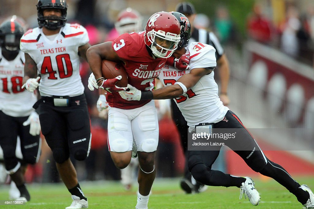 Wide receiver Sterling Shepard #3 of the Oklahoma Sooners gets tackled by defensive back Justis Nelson #31of the Texas Tech Red Raiders on October 24, 2015 at the Gaylord Family Oklahoma Memorial Stadium in Norman, Oklahoma.