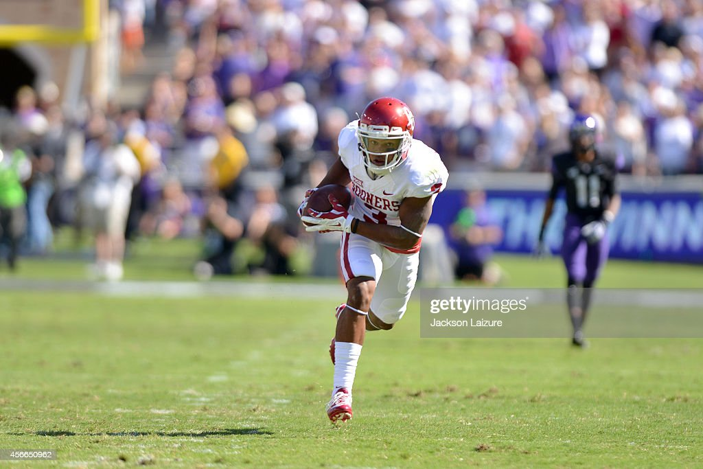 Wide receiver Sterling Shepard of the Oklahoma Sooners hauls in a touchdown pass during their game against the Texas Christian University Horned...
