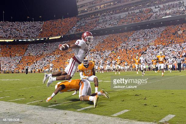 Wide receiver Sterling Shepard of the Oklahoma Sooners jumps over safety Brian Randolph of the Tennessee Volunteers and past cornerback Malik Foreman...