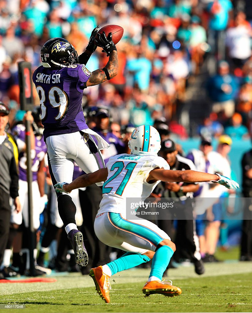 Wide receiver Steve Smith #89 of the Baltimore Ravens catches a second-half pass as cornerback Brent Grimes #21 of the Miami Dolphins defends during a game at Sun Life Stadium on December 7, 2014 in Miami Gardens, Florida.