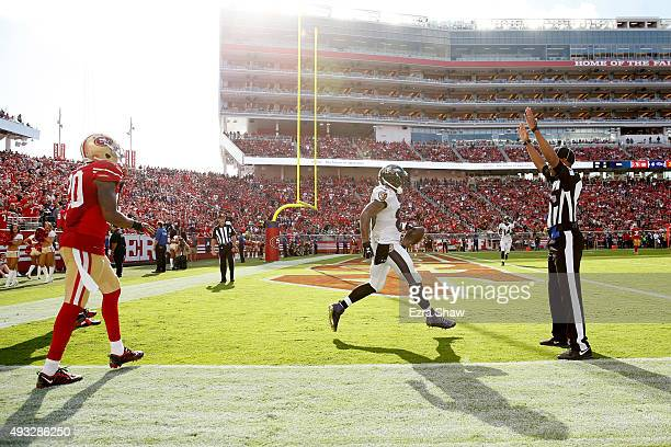 wide receiver Steve Smith of the Baltimore Ravens celebrates after a touchdown against the San Francisco 49ers during their NFL game at Levi's...