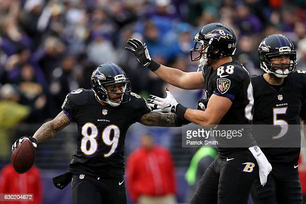 Wide receiver Steve Smith of the Baltimore Ravens celebrates with teammate tight end Dennis Pitta of the Baltimore Ravens after scoring a second...
