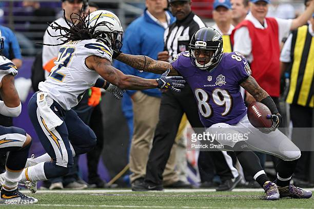 Wide receiver Steve Smith of the Baltimore Ravens eludes cornerback Jason Verrett of the San Diego Chargers during the second half at MT Bank Stadium...