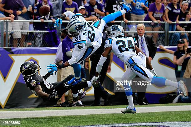 Wide receiver Steve Smith of the Baltimore Ravens free safety Thomas DeCoud of the Carolina Panthers and cornerback Josh Norman come together...