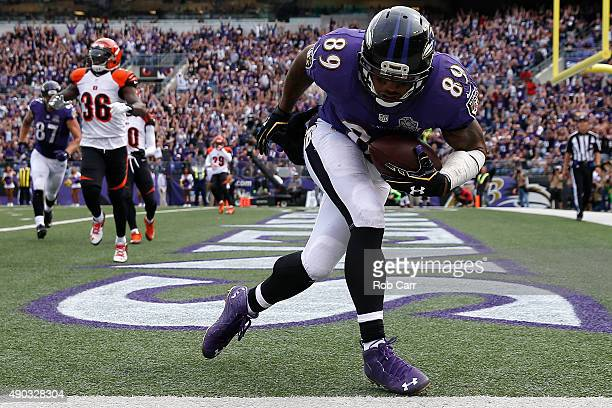 Wide receiver Steve Smith of the Baltimore Ravens scores a fourth quarter touchdown during a game against the Cincinnati Bengals at MT Bank Stadium...
