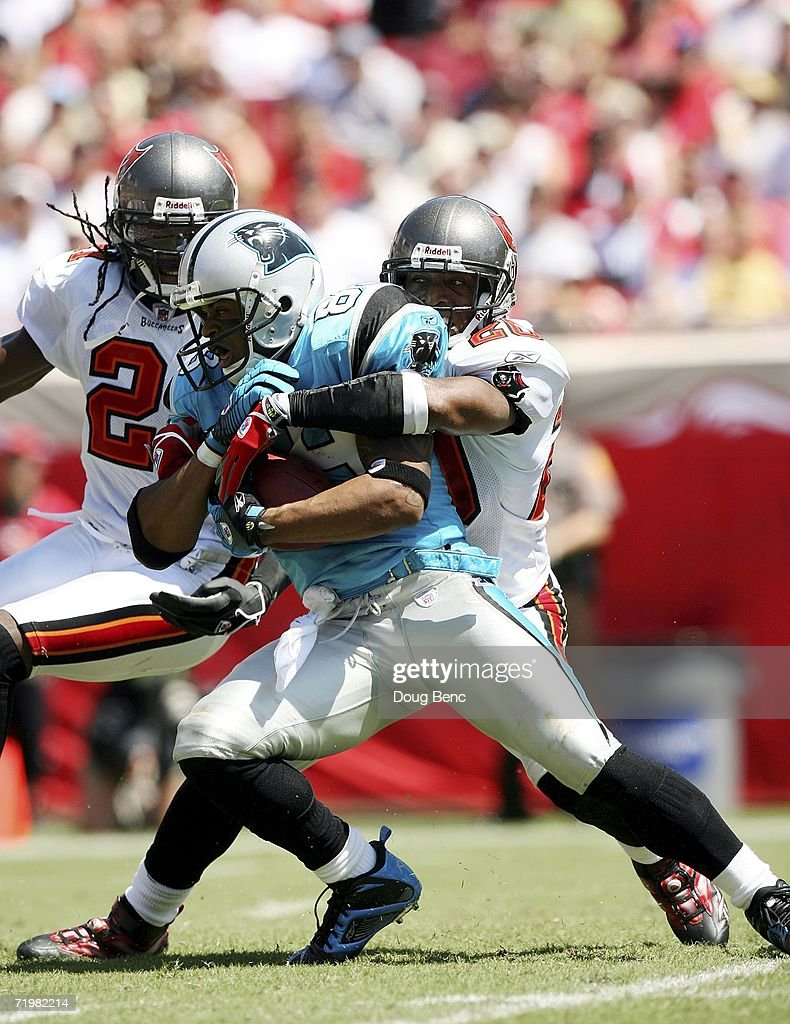 Wide receiver Steve Smith #89 of the Carolina Panthers fights for extra yardage against cornerbacks Ronde Barber #20 and Juran Bolden #21 of the Tampa Bay Buccaneers on September 24, 2006 at Raymond James Stadium in Tampa, Florida.